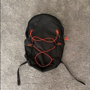 Black North Face Backpack with Red Detail